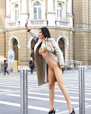 Big busted brunette babe Michaela Grauke stripping in public places