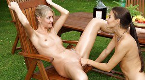 Graceful amateur lesbian gets her shaved pussy fisted outdoor
