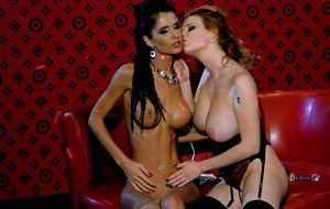 Busty lesbians Tarra White & Nessa Devil playing with a vibrator