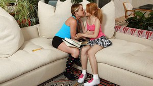 Pretty lesbian with pigtails fisting and licking her friend's tight pussy