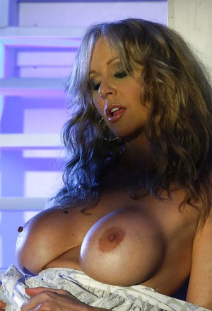 Hot MILF with big tits Julia Ann uncovering and fingering her honey pot