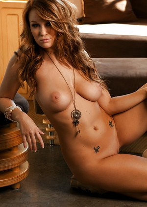 Busty hottie on high heels Leanna Decker posing barely clothed