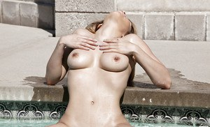 Foxy babe Roxanne Dawn uncovering her sexy curves by the pool
