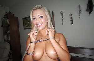 Handcuffed blonde Embry Prada showcasing her tempting curves