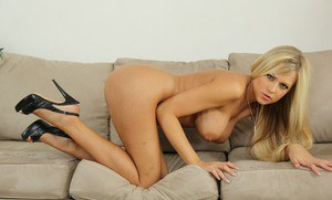 Big busted blonde babe Darcy Tyler stripping off her clothes