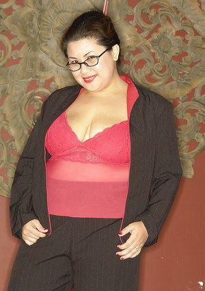 Naughty asian plumper in glasses uncovering her big flabby tits