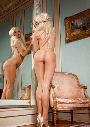 Big busted blonde on high heels Nicolette Shea taking off her lingerie