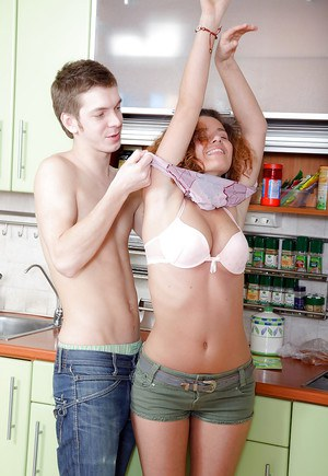 Busty teenage slut gives a blowjob and gets banged in the kitchen