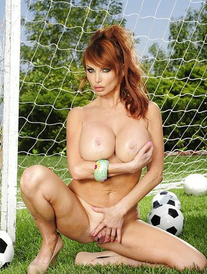 Hot MILF with big round tits Taylor Wane stripping off her clothes
