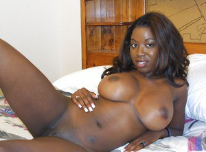 Big busted ebony chick Audree James stripping and posing naked on the bed