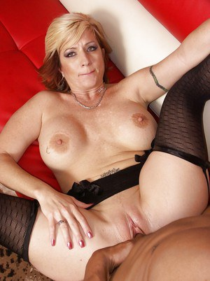 Busty mature lady Brittany Blaze is into interracial pussy pounding