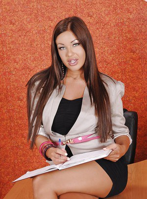 Voluptuous office babe Angelica Heart stripping and toying her pussy
