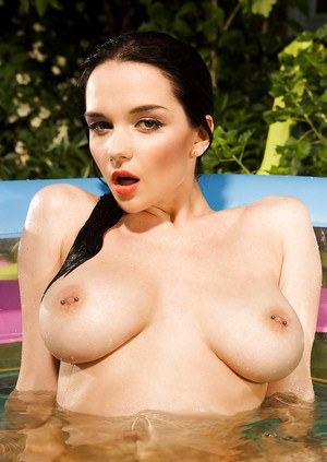 Busty brunette babe with pierced nipples posing naked outdoor