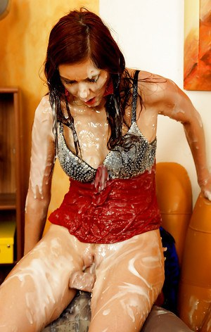 Kinky lesbians having some fun with a huge strapon and fake jizz