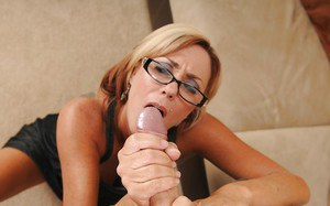 Slutty mature lady in glasses gives a handjob and gets facialized