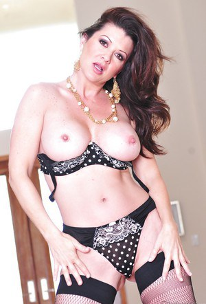 Busty MILF in lingerie Raquel Devine stripping and spreading her legs