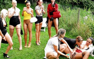 Naughty fully clothed pornstars having some lesbian fun outdoor