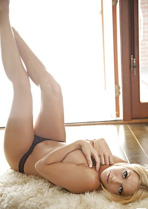 Hot blonde with petite ass Jessica Marie Love taking off her lingerie