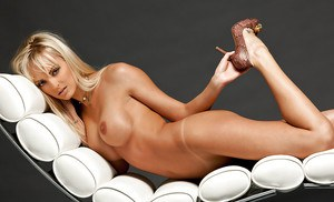 Graceful blonde on high heels Shera Bechard uncovering her big jugs