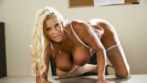 Curvaceous mature blonde JR Carrington taking off her suit and lingerie