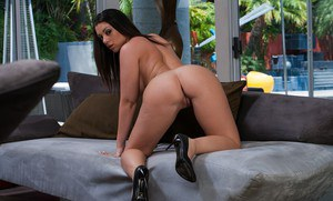 Big busted babe Melina Mason stripping and spreading her legs