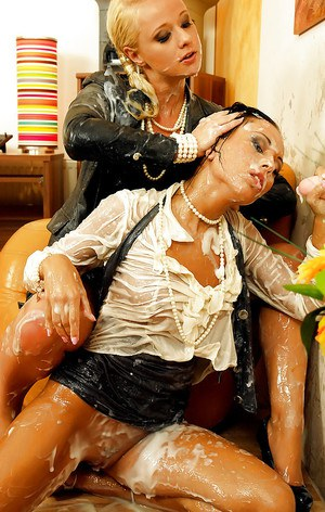 Fully clothed slut Rachel Evans is into messy bukkake action with her friend