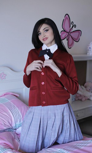 Naughty teen in school uniform Zoey Kush uncovering her tiny tits