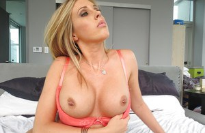 Big busted blonde babe Samantha Saint slipping off her lingerie