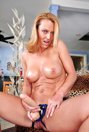 Mature vixen Brenda James taking off her lingerie and posing with strapon