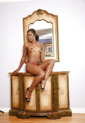 Adorable ebony babe with long legs Ms. Platinum uncovering her perky tits