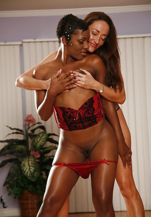 Seductive lesbians on high heels stripping and caressing each other