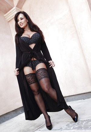 Voluptuous MILF in stockings Lisa Ann stripping and teasing her cunt