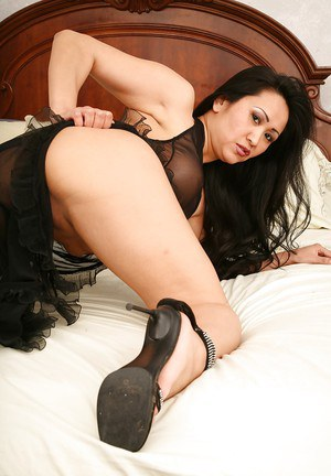 Seductive asian MILF Kitty Langdon uncovering her tempting curves
