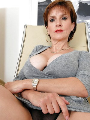 Big busted mature lady with hard nipples spreading her sexy legs
