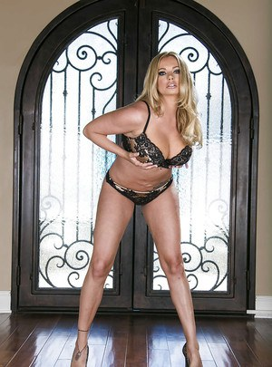 Curvaceous blonde MILF Briana Banks slipping off her lingerie