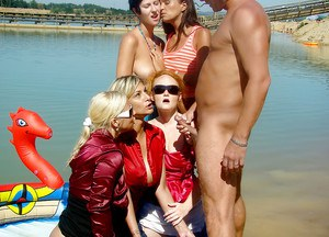 Lascivious pornstars with petite bodies are into CFNM action outdoor