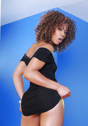 Svelte ebony babe Misty Stone slipping off her dress and panties