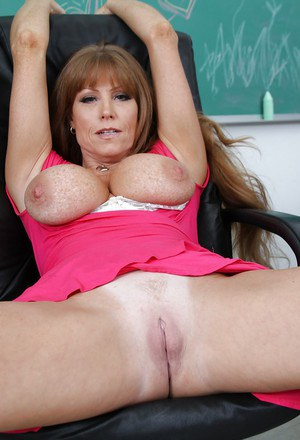 Lusty MILF Darla Crane uncovering her big boobs and taking off her panties