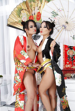 Sexy asian MILFs Annie Cruz & Asa Akira posing with toys in their assholes