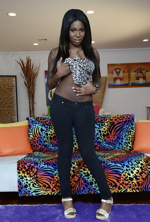 Naughty ebony pornstar Tatiyana Foxx uncovering her fuckable body