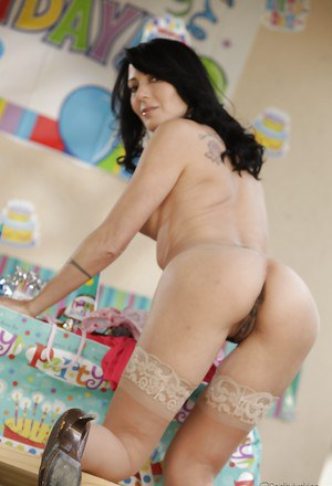 Sexy MILF in stockings Zoe Holloway stripping and spreading her legs
