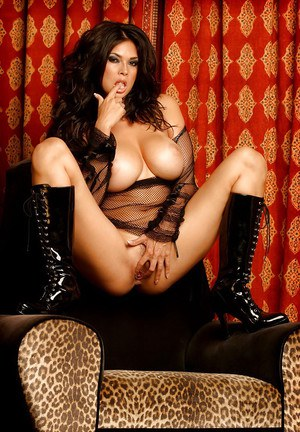 Sexy brunette babe with big jugs spreading her legs and fingering her pussy