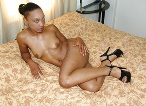 Filthy ebony MILF on high heels stripping and exposing her pussy