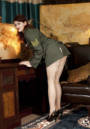 Naughty babe in army uniform Fawna Latrisch uncovering her seductive curves