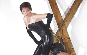 Filthy femdom in latex outfit torturing her manslaves cock