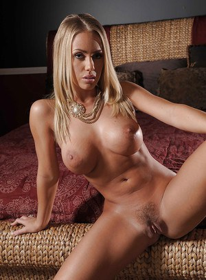 Ravishing babe with big tits Nicole Aniston uncovering her gorgeous curves