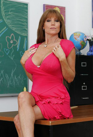 Filthy teacher Darla Crane revealing her massive jugs and trimmed pussy
