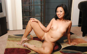 Lusty asian MILF Lucky Starr stripping and exposing her bushy cunt