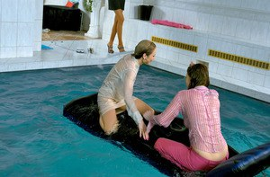 Fully clothed fetish ladies having some wet fun in the pool