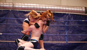 Kinky lesbians fighting in the ring and licking each other's cunts